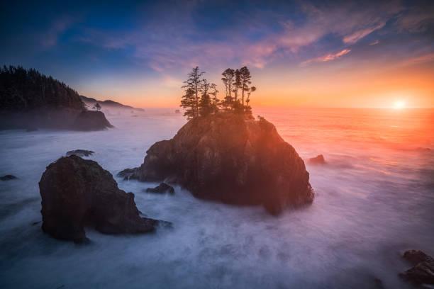 Colorful sunset and sea stacks of Oregon coast stock photo