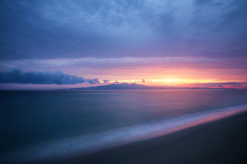 Colorful sunset on Glyfada beach (Naxos island, Greece).