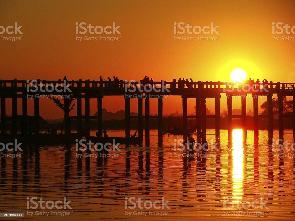 Colorful sunset at U Bein Bridge, Amarapura, Myanmar stock photo