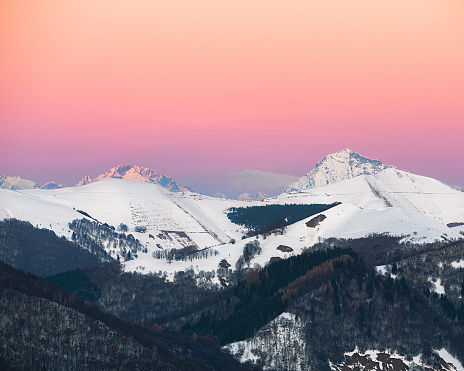 A colorful sunset in the mountains over Como, Lombardy, Italy