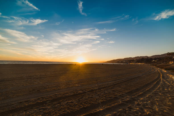Colorful sunset in world famous Santa Monica beach stock photo