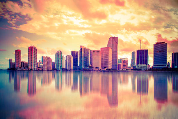 colorful sunset miami skyline - miami stock photos and pictures