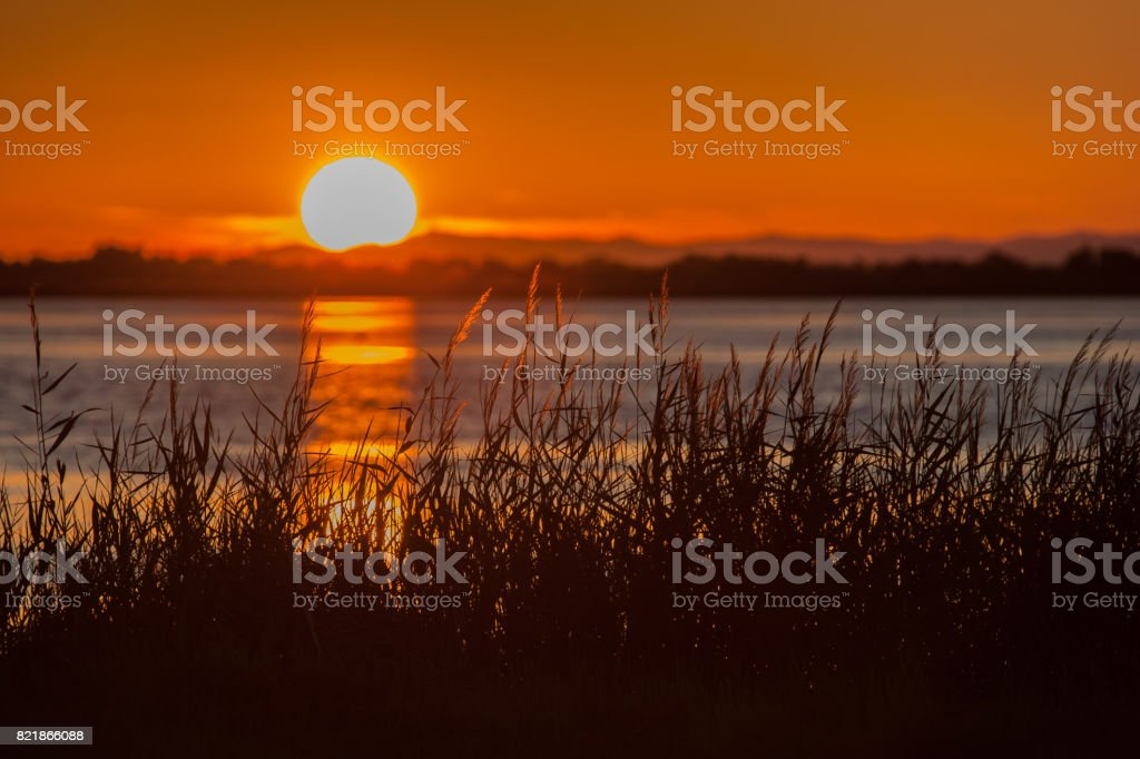 Colorful sunset on a calm lake stock photo
