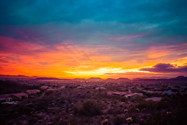Colorful Sunset over a Desert Community stock photo