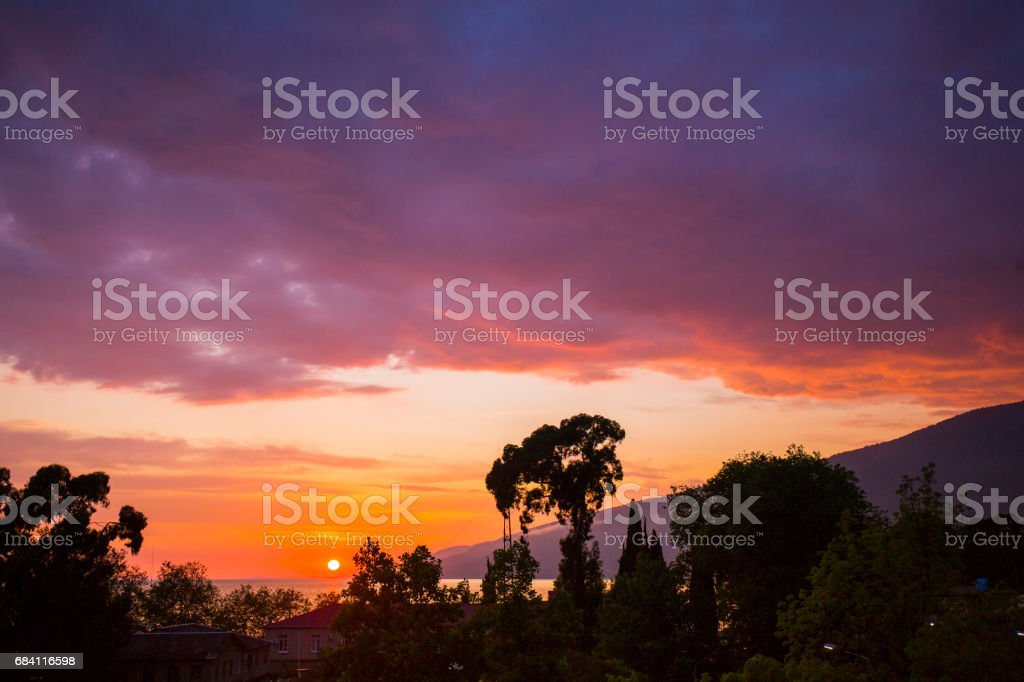 Colorful sunset over coastal town foto stock royalty-free