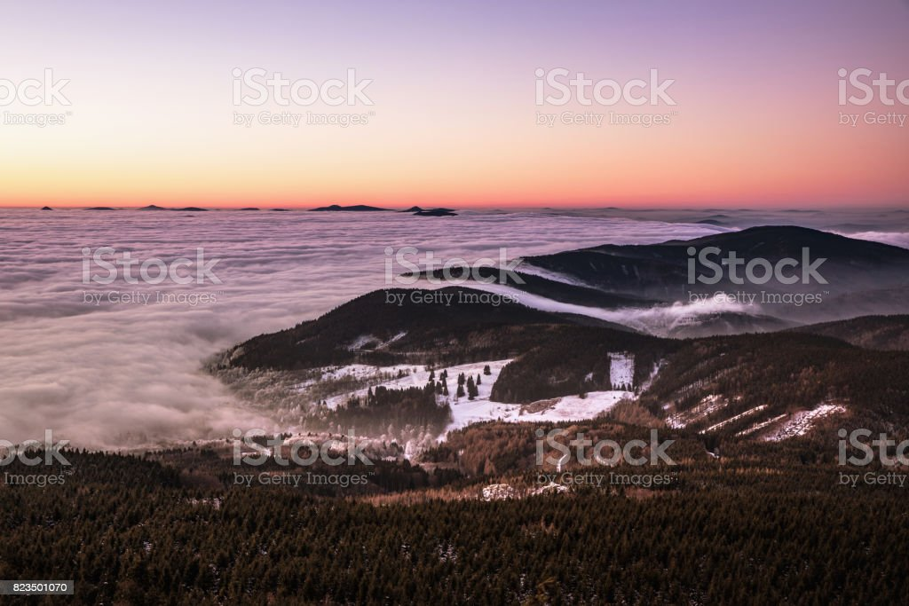 Colorful sunset over inversion in the valley stock photo