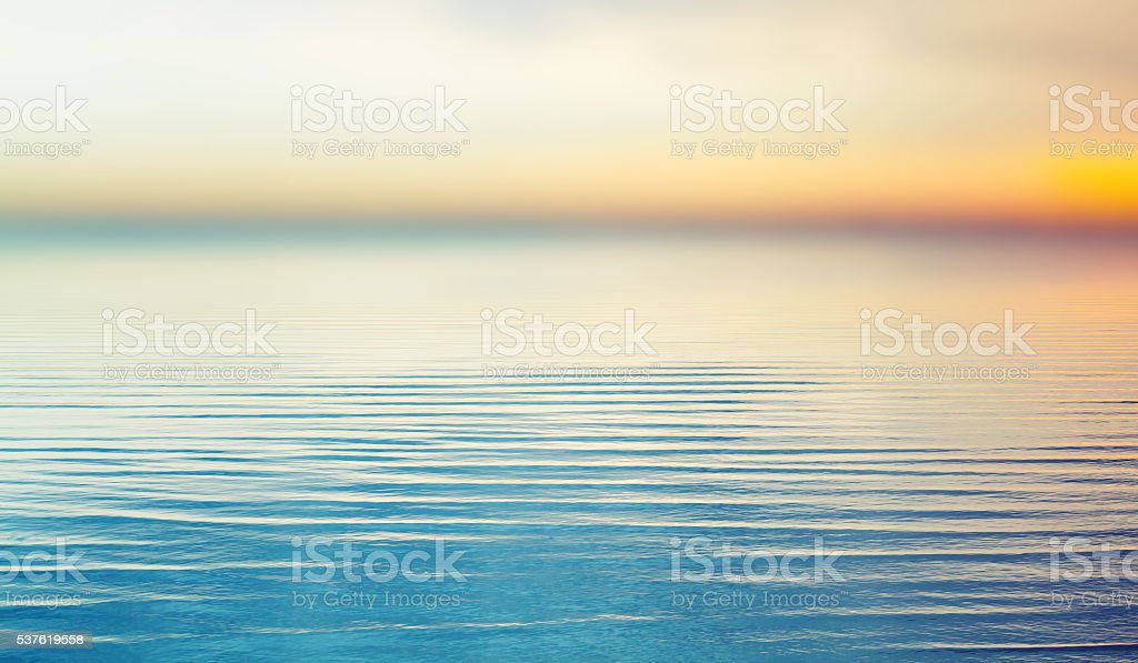 Colorful sunset over sea. Blurred background stock photo