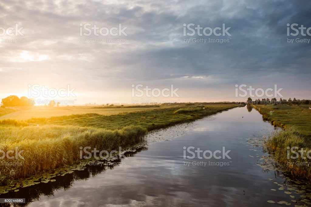 Colorful sunset over the river Treene stock photo
