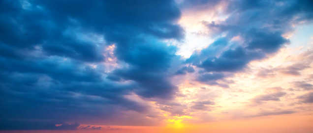 Colorful sunset over the sea with clouds. Natural background