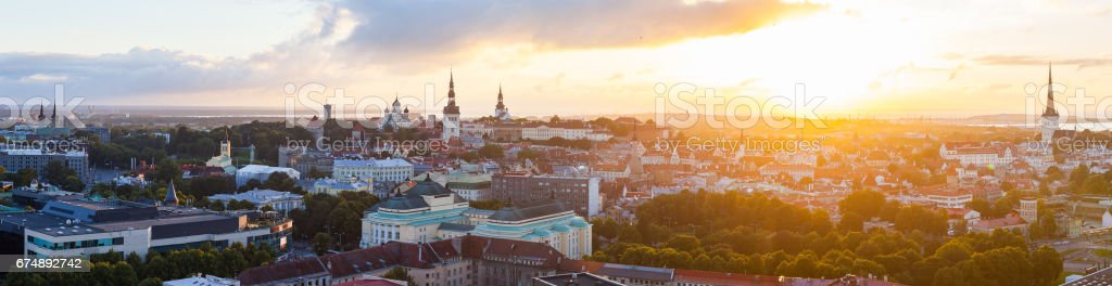 Colorful sunset over towers of old town of Tallinn, Estonia. Ultra wide panoramic view stock photo