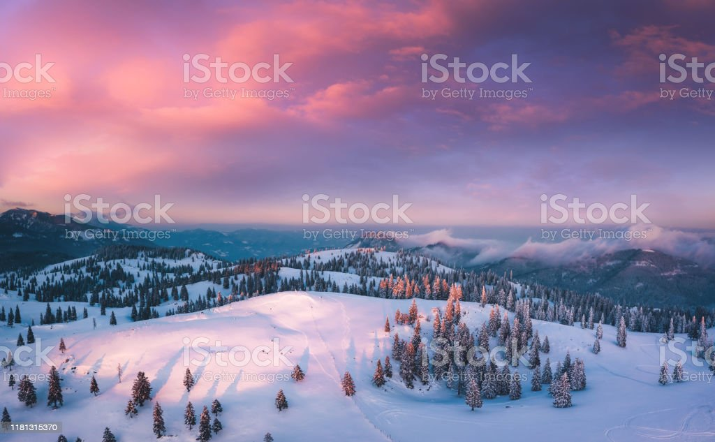 Colorful Sunset Idyllic winter landscape at sunset. View from above. Above Stock Photo