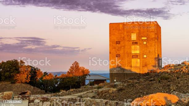Photo of Colorful sunset view of the Radar tower, cold war relic left standing on top of Mount Umunhum, Santa Cruz mountains, South San Francisco Bay Area, California