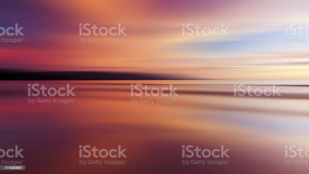 Colorful sunset with long exposure effect, motion blurred stock photo