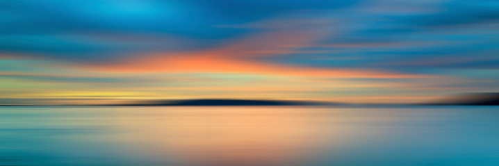 Colorful sunset with long exposure effect, motion blurred