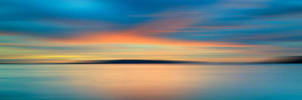 Colorful sunset with long exposure effect, motion blurred Colorful sunset with long exposure effect, motion blurred long exposure stock pictures, royalty-free photos & images