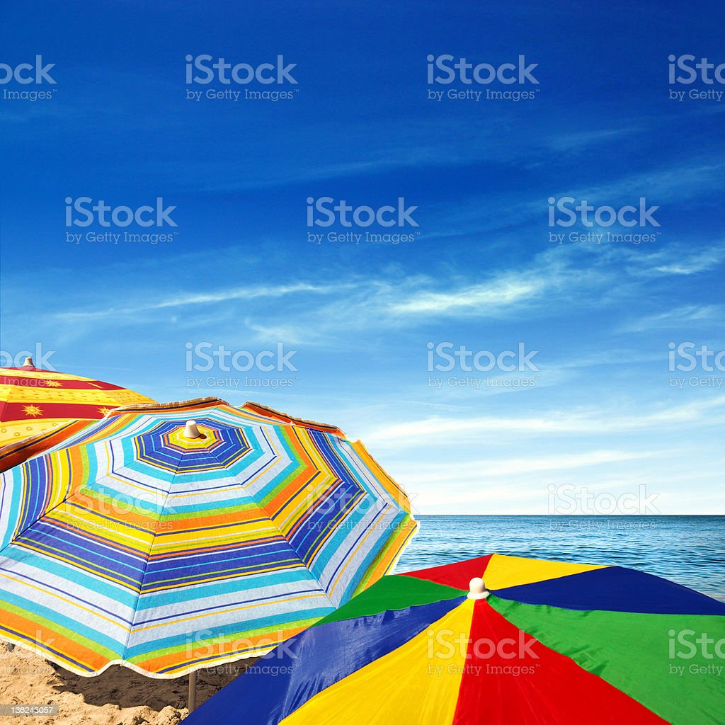 Colorful Sunshades Detail of colorful sunshades in the beach on a sunny summer day Backgrounds Stock Photo