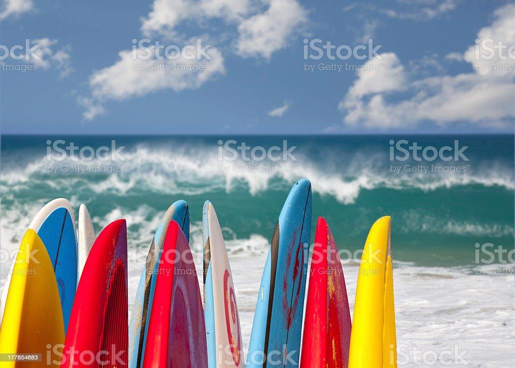 Colorful surf boards by the ocean at Lumahai Beach, Kauai stock photo
