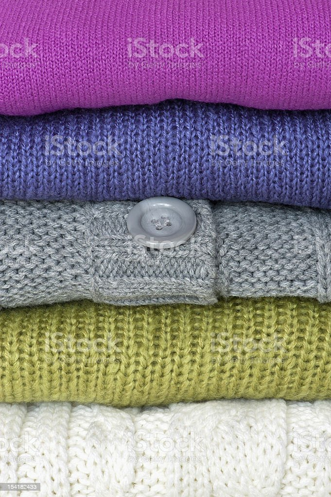 Colorful sweaters folded and stacked royalty-free stock photo