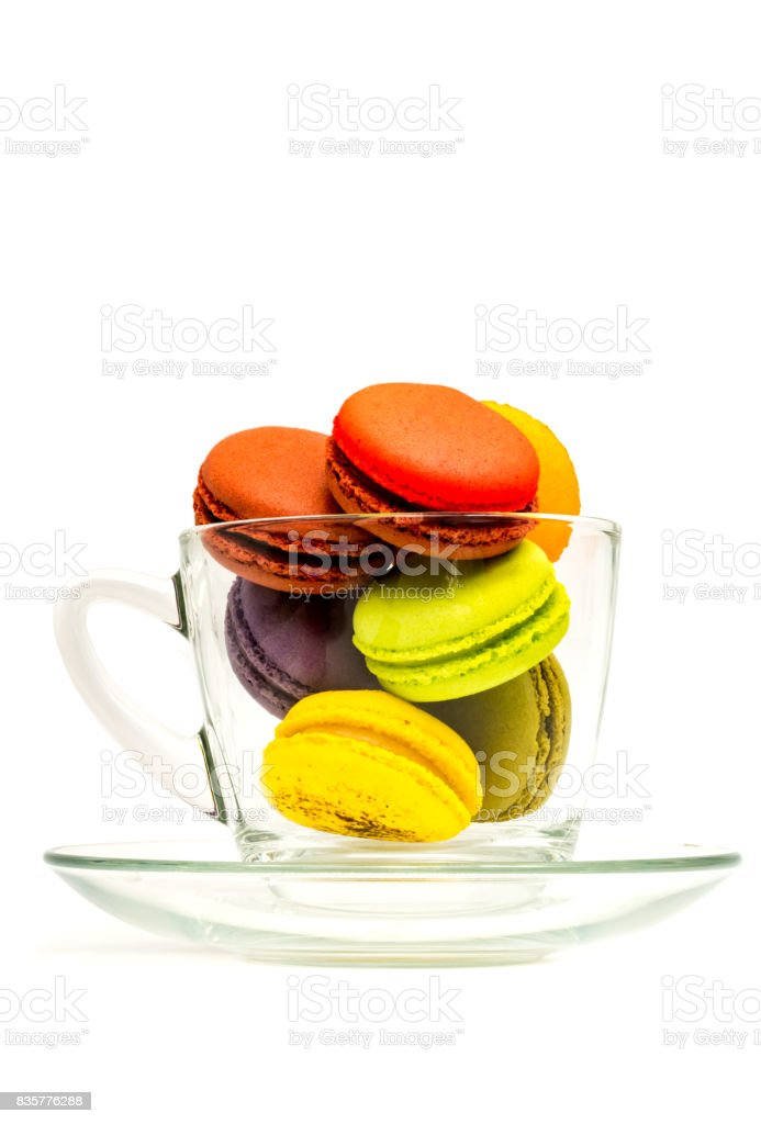 Colorful sweet macarons in a glass stock photo