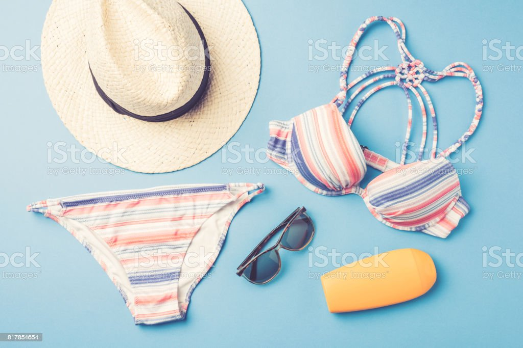 Colorful swimsuit with beach accessories stock photo