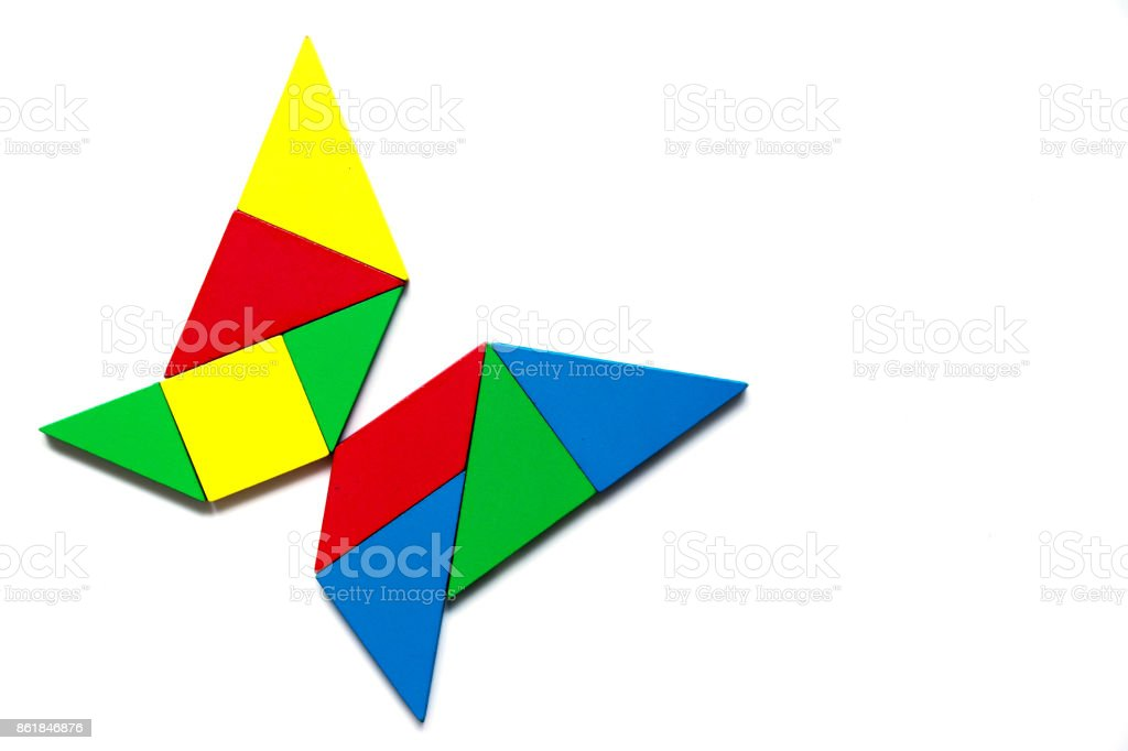 Colorful tangram as butterfly shape on white background stock photo
