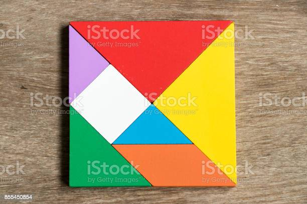 Colorful tangram puzzle in square shape on wood background picture id855450854?b=1&k=6&m=855450854&s=612x612&h=uockqrgvuoxp6fkbybst kdpwwc5wycljfp 8xbcwtc=