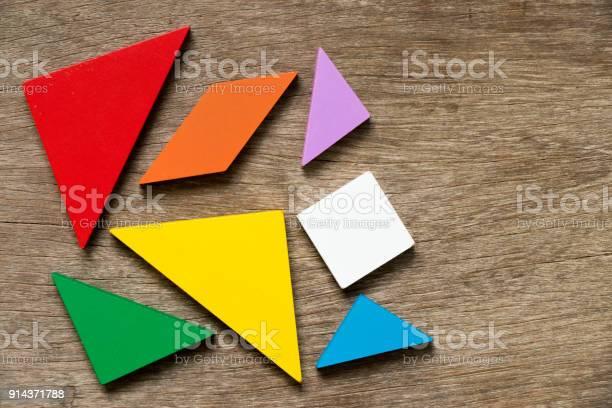 Colorful tangram puzzle wait to develop shape on wood background picture id914371788?b=1&k=6&m=914371788&s=612x612&h=utkiz4uwq4y3qhzu0 e3hkq0bbvktd5g3tjpym5cgrs=