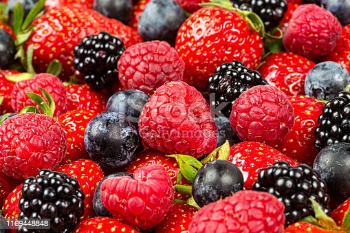 610771802 istock photo colorful tasty mix of wild forest berry fruits. Strawberry blueberry raspberry and blackberry. healthy eating nutrition vegan food concept background 1169448848