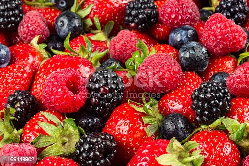 610771802 istock photo colorful tasty mix of wild forest berry fruits. Strawberry blueberry raspberry and blackberry. healthy eating nutrition vegan food concept background 1169449902