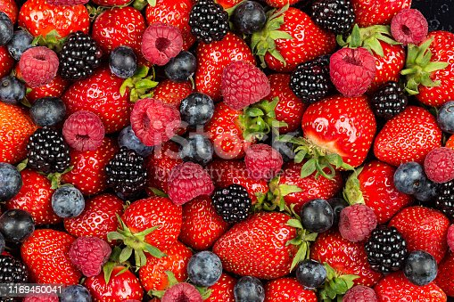 610771802 istock photo colorful tasty mix of wild forest berry fruits. Strawberry blueberry raspberry and blackberry. healthy eating nutrition vegan food concept background 1169450041