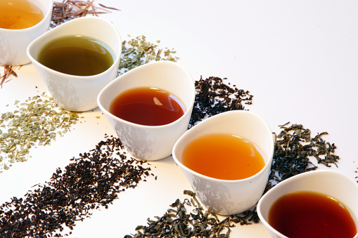 Colorful tea selection - different types of loose tea in small cups