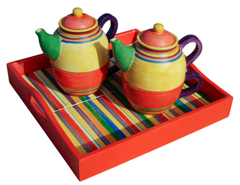 Colorful teapots on white