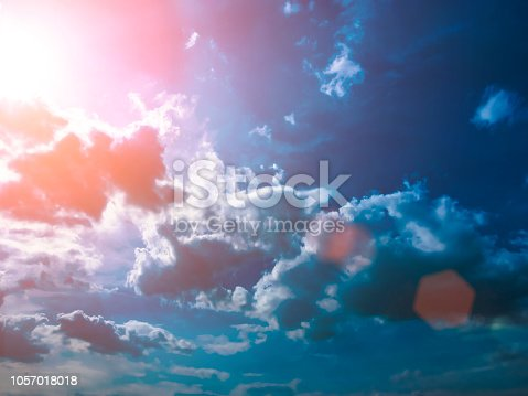 istock Colorful technology clouds on dramatic sunset sky 1057018018