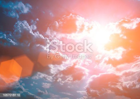 istock Colorful technology clouds on dramatic sunset sky 1057018110