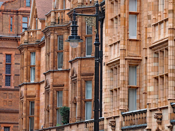 Colorful terracotta facades of apartment buildings in the Mayfair district of London, England Colorful terracotta facades of apartment buildings in the Mayfair district of London, England mayfair stock pictures, royalty-free photos & images