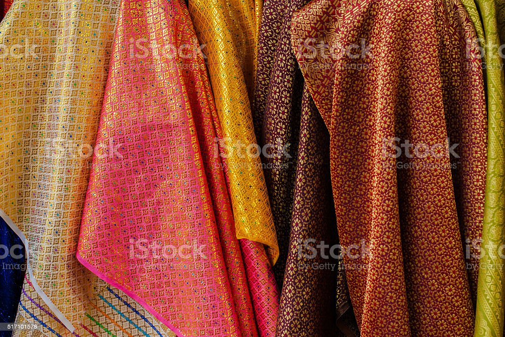 colorful thai brocade fabric stock photo