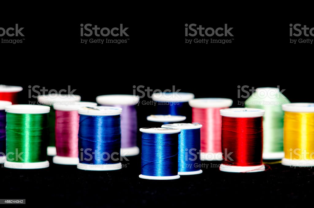 Colorful thread awaits stock photo