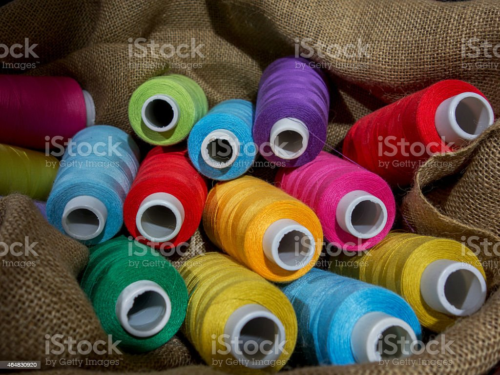 colorful thread reels stock photo