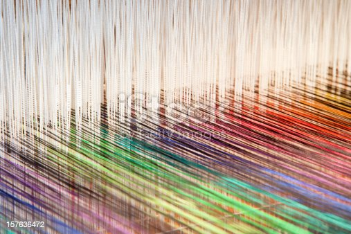 Colorful threads on an old-fashioned loom (XXL)