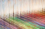 Colorful threads on a loom (XXL)