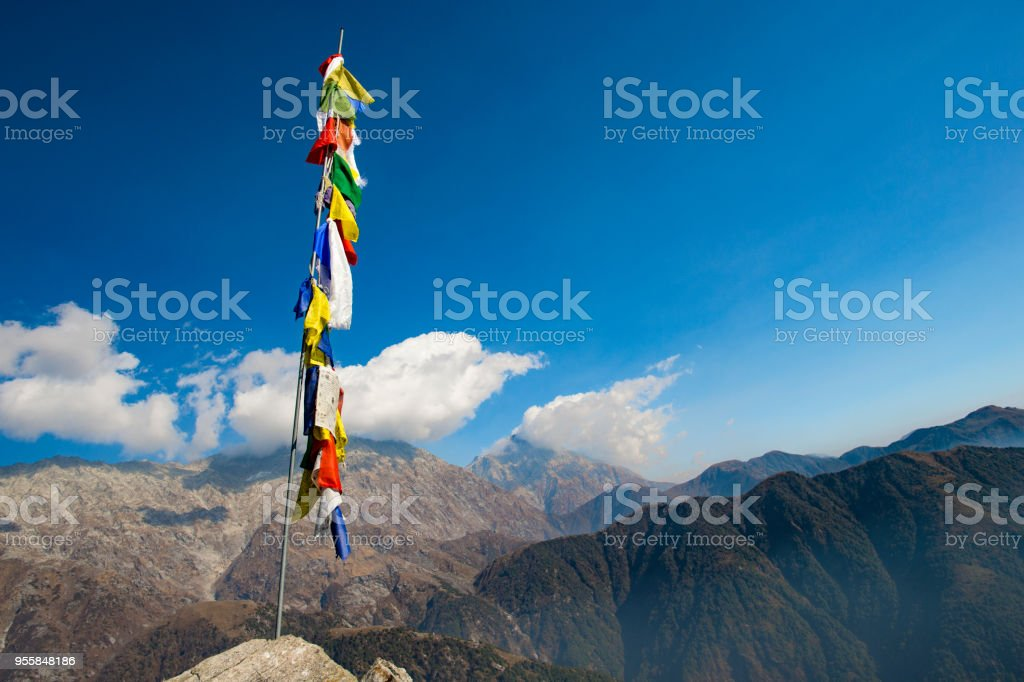 Colorful Tibetan Flags With Mantras On The Summit Of A