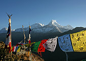 view of the Annapurna range with colourful tibetan prayer flags