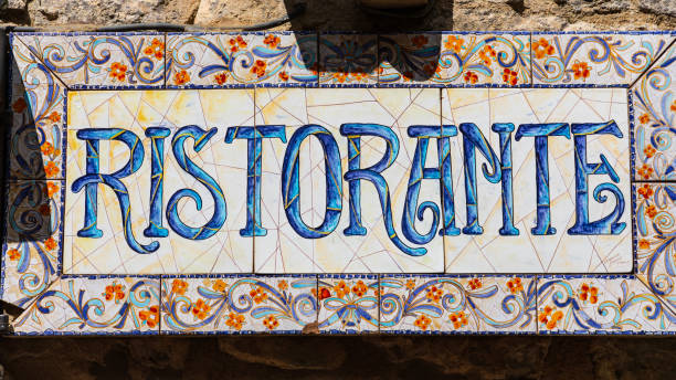 Colorful tile sign for a restaurant in the hill town of Erice. stock photo