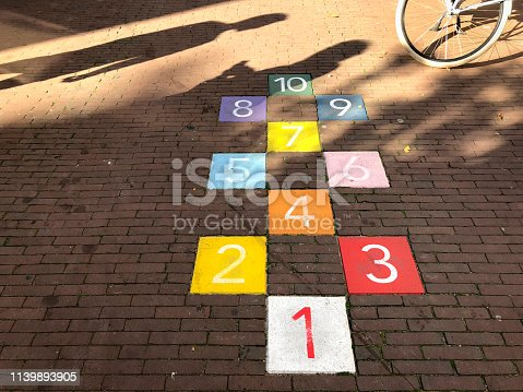 istock Colorful tiles in an Amsterdam sidewalk for playing hopscotch 1139893905