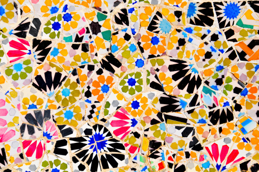 Colorful tiles patchwork close up in Gaudi Park Barcelona Spain