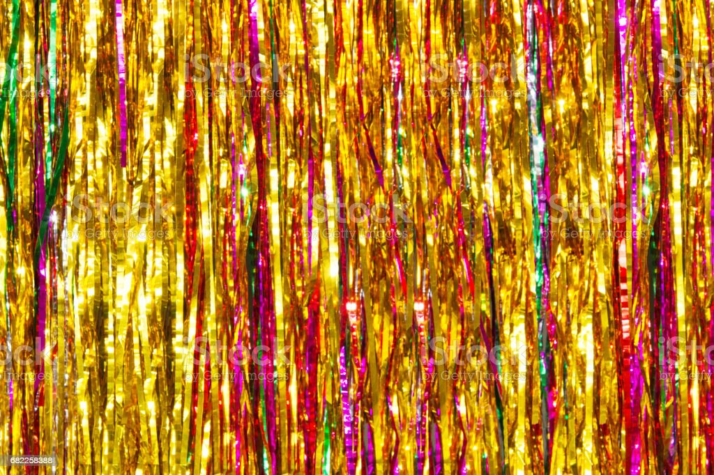Colorful tinsel. Christmas blurred background stock photo