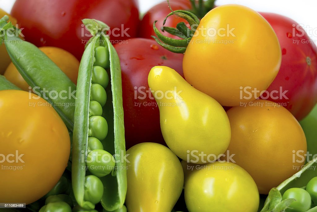 colorful tomatoes and sugar beans stock photo