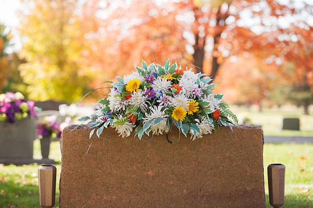 colorful tombstone boquet - graf stockfoto's en -beelden