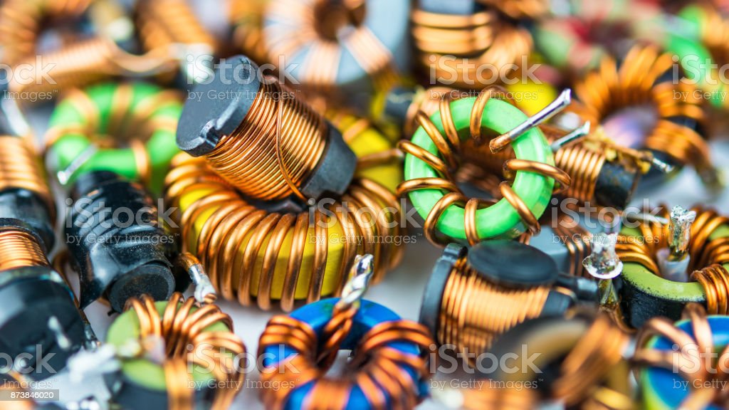 Colorful toroidal coils with magnetic core and copper winding. Concept for research, development, science and technology stock photo