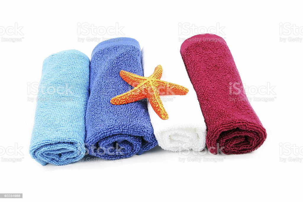 Colorful towels and orange starfish royalty-free stock photo